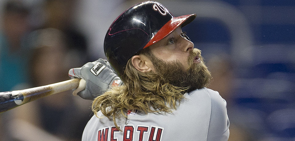 Photo - Washington Nationals batter Jayson Werth flies out during the first inning of a baseball game against the Miami Marlins in Miami, Wednesday, July 30, 2014. (AP Photo/J Pat Carter)