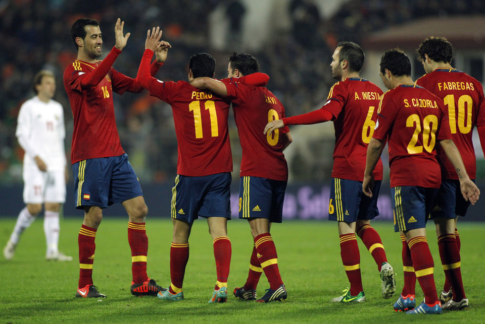 Spain's players celebrate Pedro Rodriguez's score during a World Cup 2014 Group qualification match between Belarus and Spain national teams in Minsk, Belarus, on Friday, Oct. 12, 2012.(AP Photo/Sergei Grits)