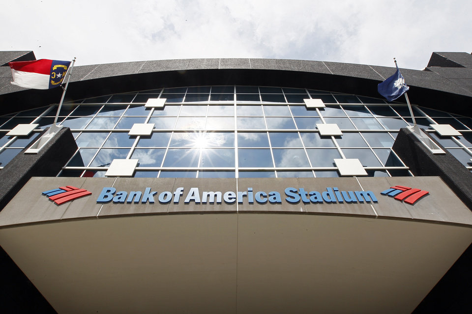 This, Saturday, Aug. 11, 2012, photo, shows the Bank of America Stadium prior to an NFL preseason football game. U.S. banks earned more from July through September than in any other quarter over the past six years. The increase is further evidence that the industry is strengthening four years after the 2008 financial crisis. (AP Photo/Gerry Broome)