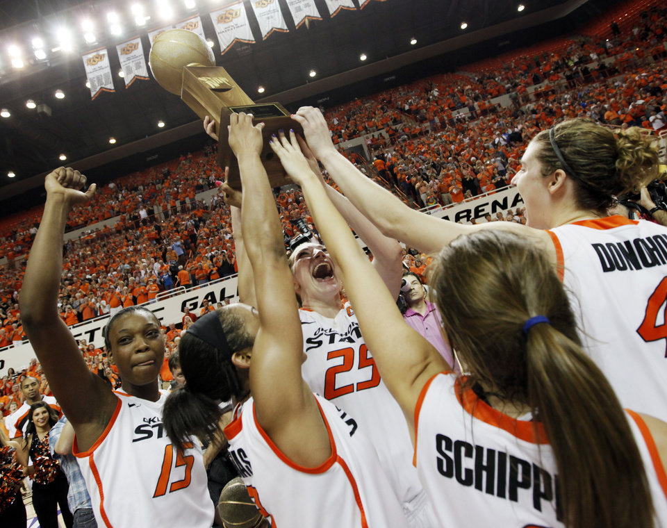OSU Cowgirls, from left, Toni Young (15), Tiffany Bias (3), Lindsey Keller (25), Taylor Schippers (1), and Liz Donohoe (4) celebrate with the WNIT championship trophy the Women\'s NIT championship college basketball game between Oklahoma State University and James Madison at Gallagher-Iba Arena in Stillwater, Okla., Saturday, March 31, 2012. OSU won, 75-68. Photo by Nate Billings, The Oklahoman