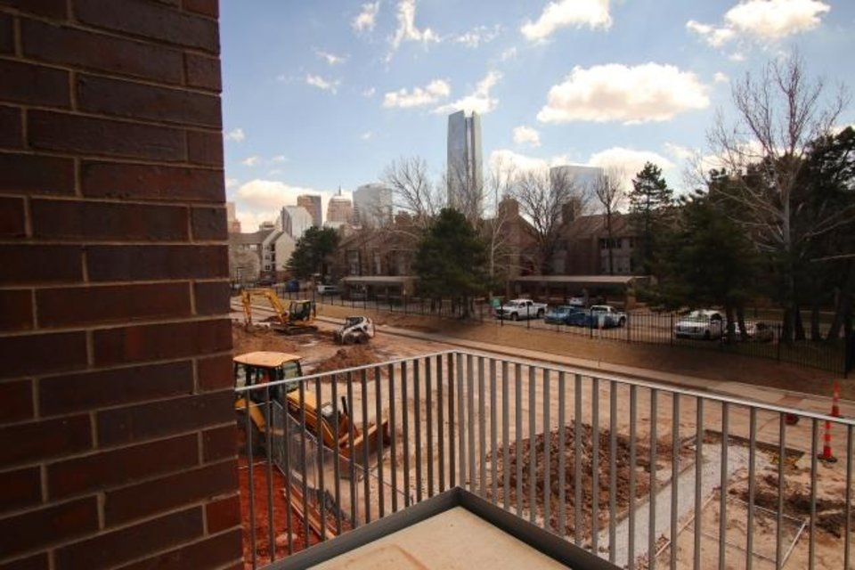 Photo -  A balcony at the Bower condominium and townhomes at NW 4 and Lee, has a view of the downtown skyline.  [Doug Hoke/The Oklahoman]
