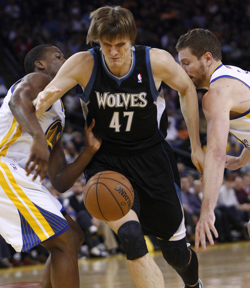 Photo - Minnesota Timberwolves' Andrei Kirilenko (47) loses control of the ball between Golden State Warriors' Harrison Barnes, left and David Lee during the first half of an NBA basketball game, Tuesday, April 9, 2013, in Oakland, Calif. (AP Photo/George Nikitin)