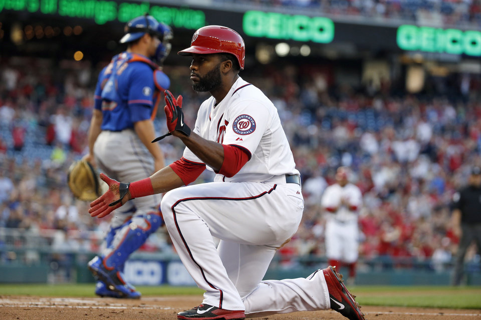 Photo - Washington Nationals' Denard Span is safe at home after the tag was late by New York Mets catcher Anthony Recker during the first inning of a baseball game at Nationals Park Friday, May 16, 2014, in Washington. (AP Photo/Alex Brandon)