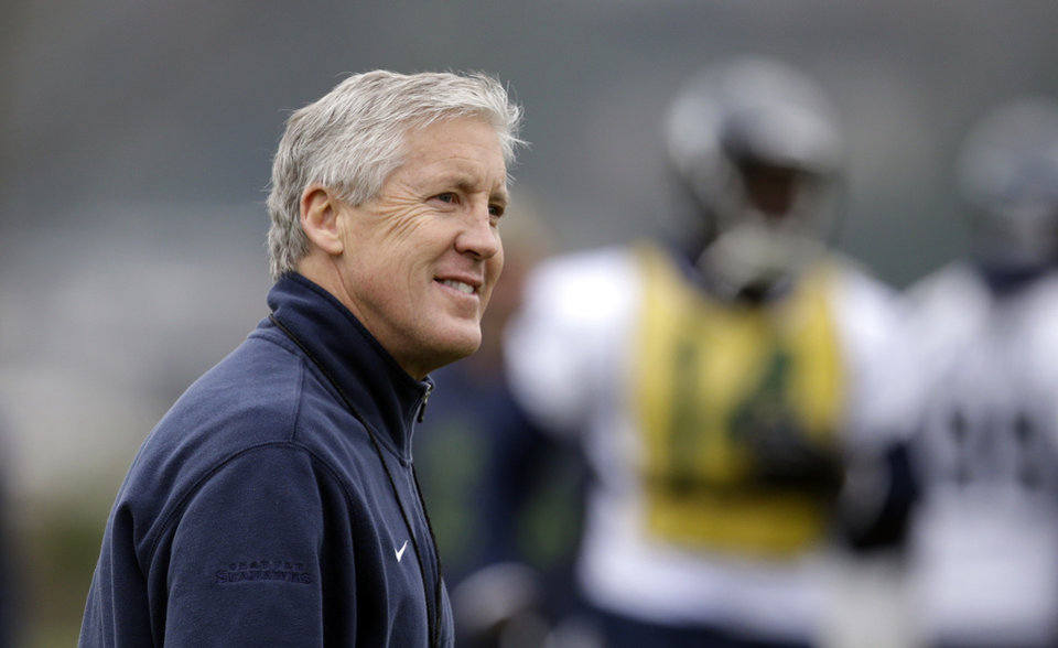 Photo - Seattle Seahawks head coach Pete Carroll walks on the field at an NFL football practice Thursday, Jan. 16, 2014, in Renton, Wash. The Seahawks play the San Francisco 49ers Sunday in the NFC championship game. (AP Photo/Elaine Thompson)