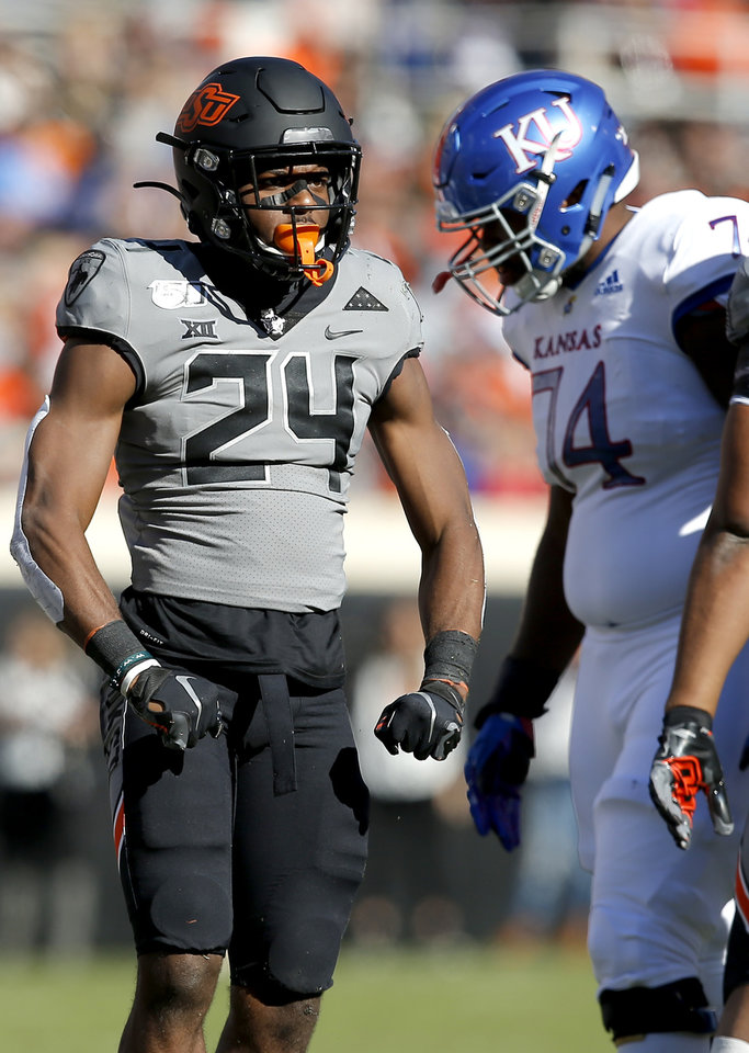 Photo - Oklahoma State's Jarrick Bernard (24) celebrates a play in the third quarter during the college football game between the Oklahoma State University Cowboys and the Kansas Jayhawks at Boone Pickens Stadium in Stillwater, Okla., Saturday, Nov. 16, 2019. OSU won 31-13. [Sarah Phipps/The Oklahoman]