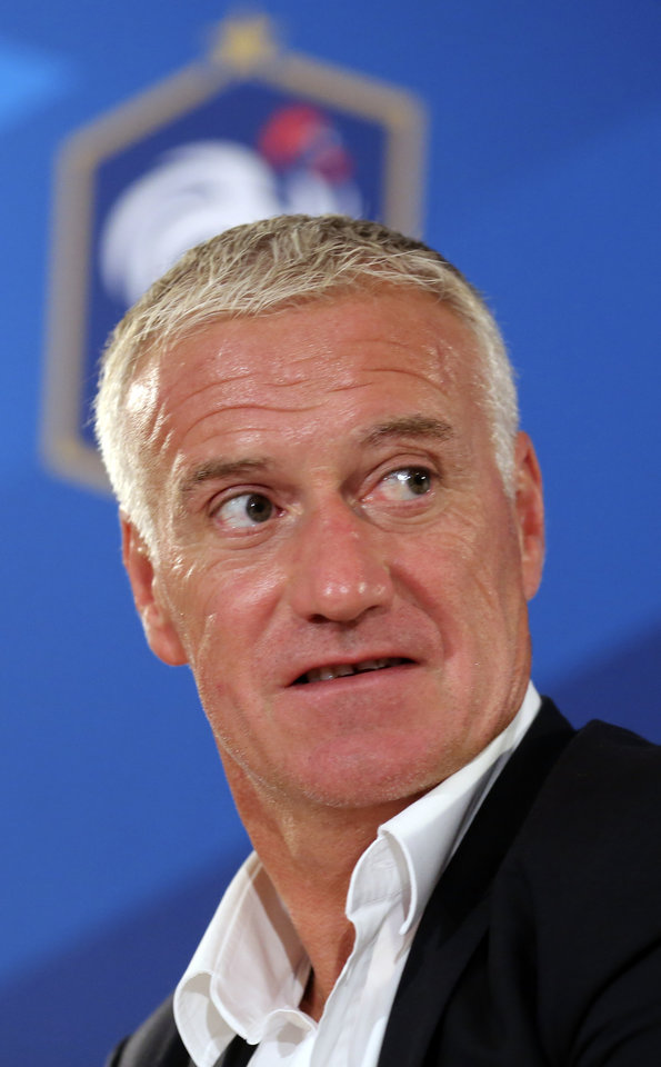 Photo - French national soccer team coach Didier Deschamps leaves at the end of a press conference in Paris, Thursday Aug. 28, 2014. France will face Spain Thursday Sept. 4,  in a friendly match in Paris. (AP Photo/Remy de la Mauviniere)