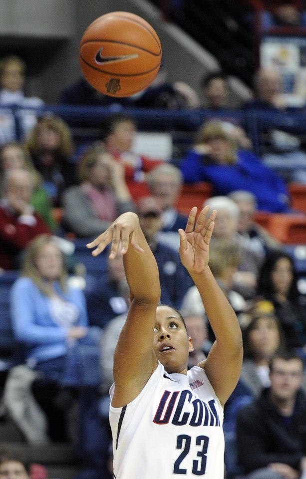 Photo - Connecticut's Kaleena Mosqueda-Lewis shoots during the second half of her team's 94-37 victory over Marquette in an NCAA college basketball game in Storrs, Conn., Tuesday, Feb. 5, 2013. Mosqueda-Lewis scored a game-high 22 points in the victory. (AP Photo/Fred Beckham)