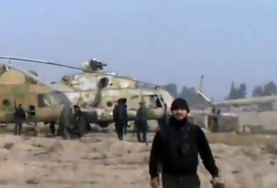 Photo -   In this image taken from video obtained from the Ugarit News, which has been authenticated based on its contents and other AP reporting, Syrian rebels capture a helicopter air base near the capital Damascus after fierce fighting in Syria, on Sunday, Nov. 25, 2012. The takeover claim showed how rebels are advancing in the area of the capital, though they are badly outgunned by Assad's forces, making inroads where Assad's power was once unchallenged. Rebels have also been able to fire mortar rounds into Damascus recently. (AP Photo/Ugarit News via AP video)