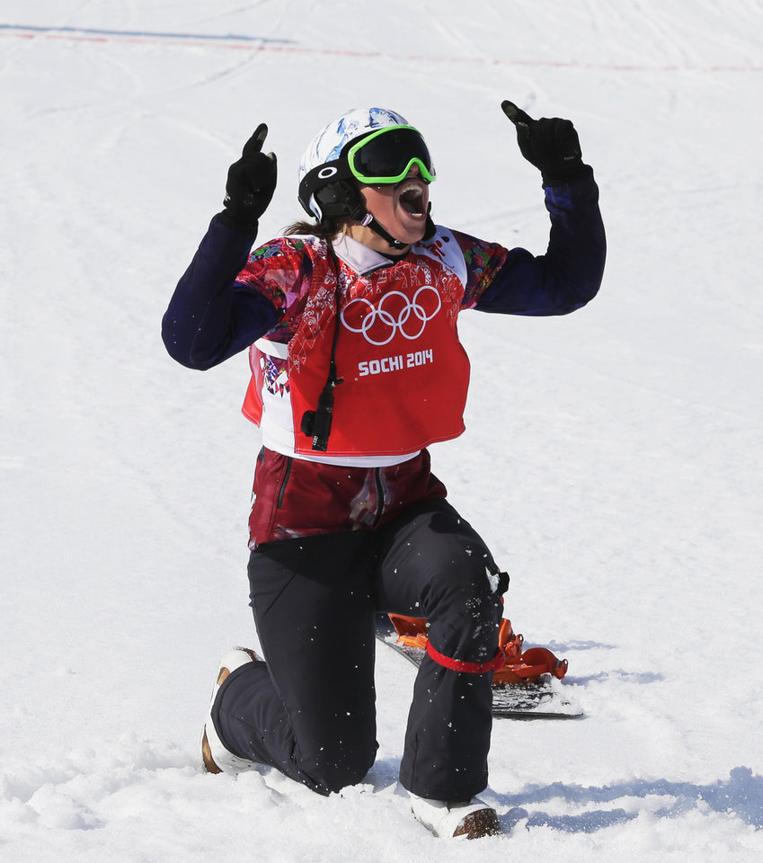 Photo - Czech Republic's Eva Samkova celebrates after taking the gold medal in the women's snowboard cross final at the Rosa Khutor Extreme Park, at the 2014 Winter Olympics, Sunday, Feb. 16, 2014, in Krasnaya Polyana, Russia. (AP Photo/Andy Wong)