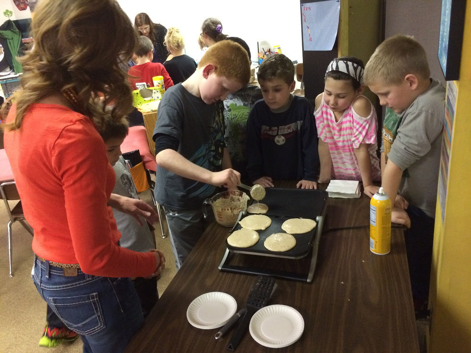 Photo - Lesli Downs, left, from John's Farm, works with Trevor Calwonsen, Kaden Pettus, Korbin Snesrud, Zoey Bryant, and Ethan Wallace to make pancakes from local flour. PHOTO BY SHERREL JONES, THE OKLAHOMAN   SHERREL JONES - THE OKLAHOMAN