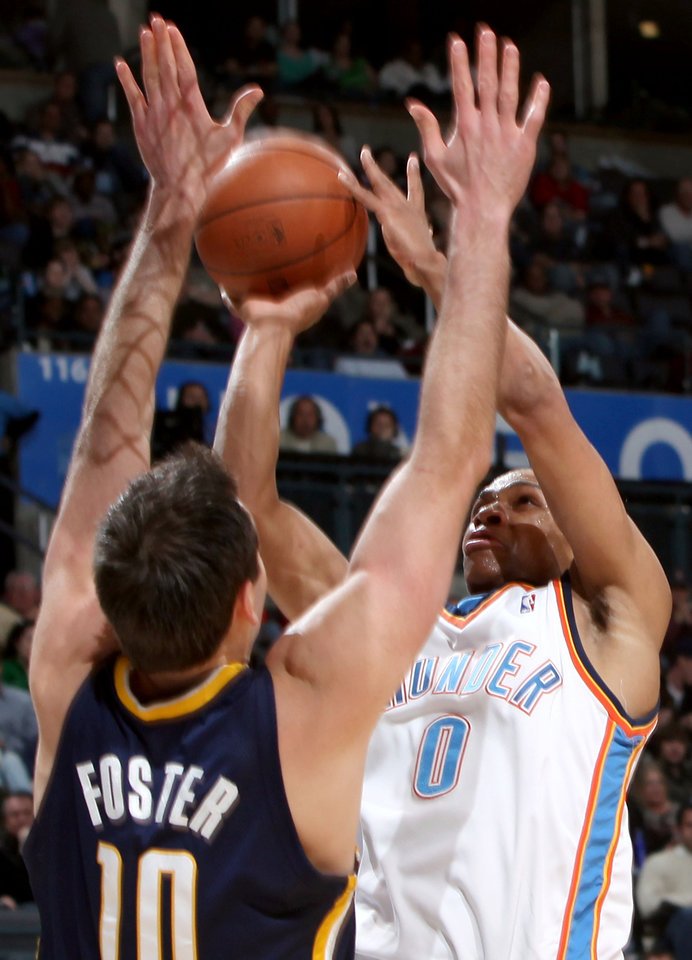 Photo - Oklahoma City's Russell Westbrook is pressured by Indiana's Jeff Foster during the NBA basketball game between the Indiana Pacers and the Oklahoma City Thunder at the Ford Center in Oklahoma City, Sunday, April 5, 2009. The Thunder lost 117 to 99. Photo by John Clanton, The Oklahoman