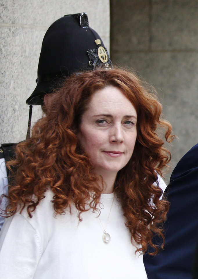 Photo - Rebekah Brooks, former News International chief executive, leaves the Central Criminal Court in London, Tuesday, June 24, 2014. Former News of the World editor Andy Coulson was convicted of phone hacking Tuesday, but fellow editor Rebekah Brooks was acquitted after a monthslong trial centering on illegal activity at the heart of Rupert Murdoch's newspaper empire. A jury at London's Old Bailey unanimously found Coulson, the former spin doctor of British Prime Minister David Cameron, guilty of conspiring to intercept communications. Brooks was acquitted of that charge and of counts of bribing officials and obstructing police. The nearly eight-month trial was triggered by revelations that for years the News of the World used illegal eavesdropping to get stories, listening in on the voicemails of celebrities, politicians and even crime victims. (AP Photo/Lefteris Pitarakis)