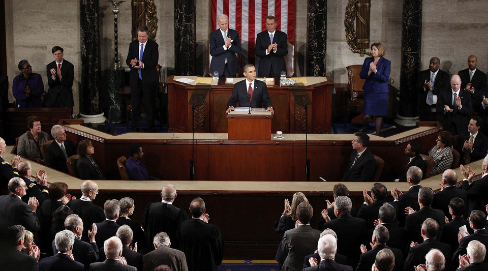 Photo - President Barack Obama pauses during the State of the Union address at the Capitol in Washington, Tuesday, Jan. 24, 2012. (AP Photo/J. Scott Applewhite) ORG XMIT: CAP206