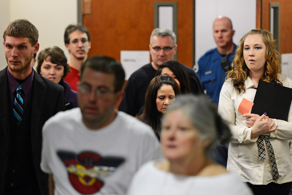Photo - Family members and victims affected by the Aurora theater shooting arrive at court, Tuesday, Jan. 8, 2012, on the second day of hearings for accused gunman James Holmes, in Centenneial, Colo. (AP Photo/The Denver Post, RJ Sangosti) MAGS OUT; TV OUT; INTERNET OUT