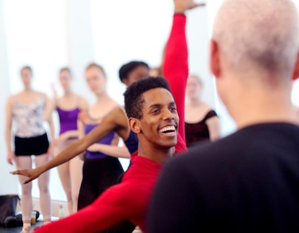Photo -  Oklahoma City Ballet Principal Dancer Jonathan Batista rehearses April 8 as Paul Boos, repetiteur with the George Balanchine Trust,   looks on at the Susan E. Brackett Dance Center. [Doug Hoke/The Oklahoman]