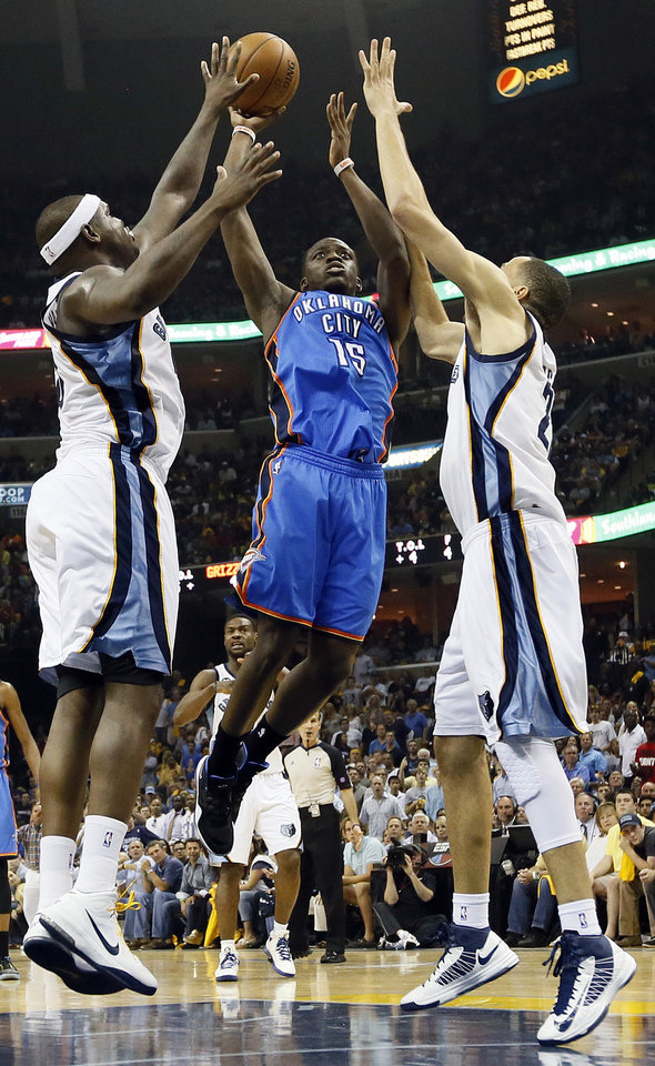 Photo - Oklahoma City's Reggie Jackson (15) shoots between Memphis' Zach Randolph (50) and Tayshaun Prince (21) during Game 3 in the second round of the NBA basketball playoffs between the Oklahoma City Thunder and Memphis Grizzles at the FedExForum in Memphis, Tenn., Saturday, May 11, 2013. Photo by Nate Billings, The Oklahoman