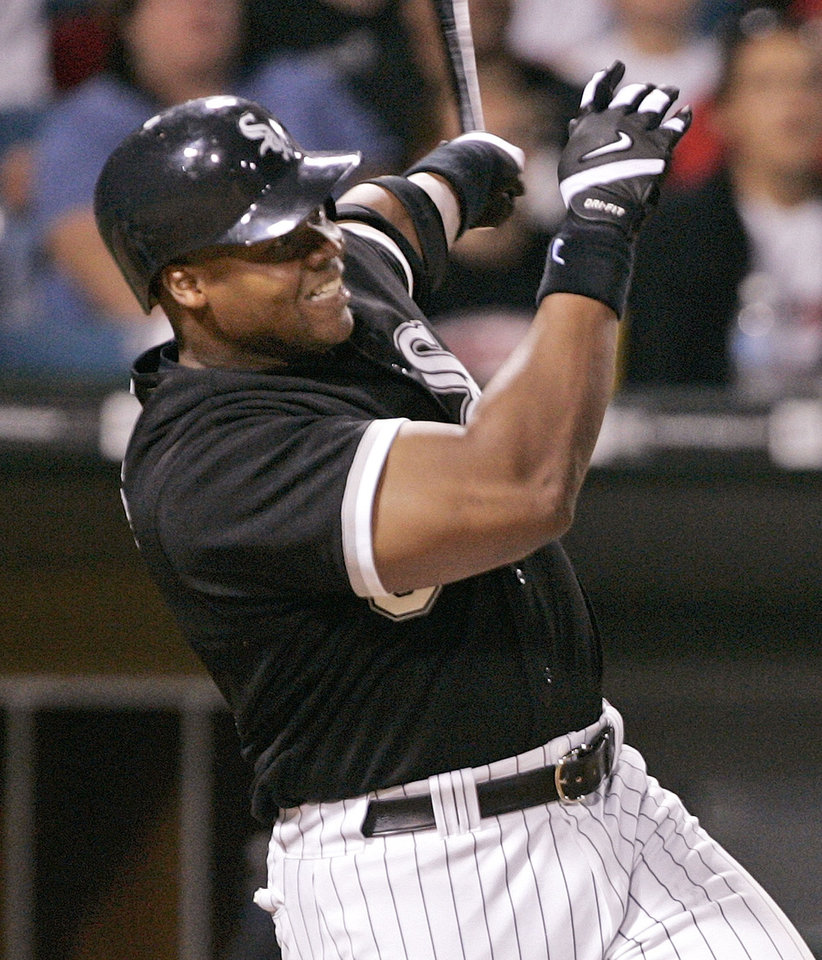 Photo - FILE - In this July 5, 2005, file photo, Chicago White Sox's Frank Thomas hits a three-run home run during the eighth inning of a baseball game against the Tampa Bay Devil Rays in Chicago. Thomas was elected to the Baseball Hall of Fame in voting by the Baseball Writers' Association of America, Wednesday, Jan. 8, 2014. (AP Photo/Brian Kersey, File)