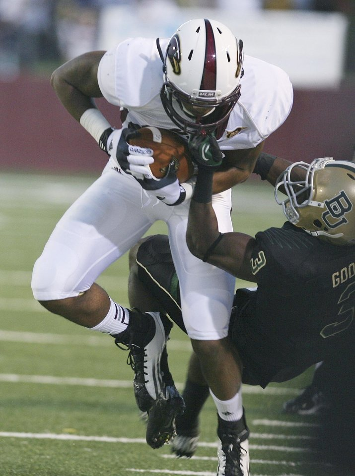 Photo -   Baylor's Demetri Goodson (3) tackles Louisiana-Monroe's Josh Allen (86) during an NCAA college football game Friday, Sept. 21, 2012, in Monroe, La. (AP Photo/The News-Star, Arely D. Castillo) NO SALES