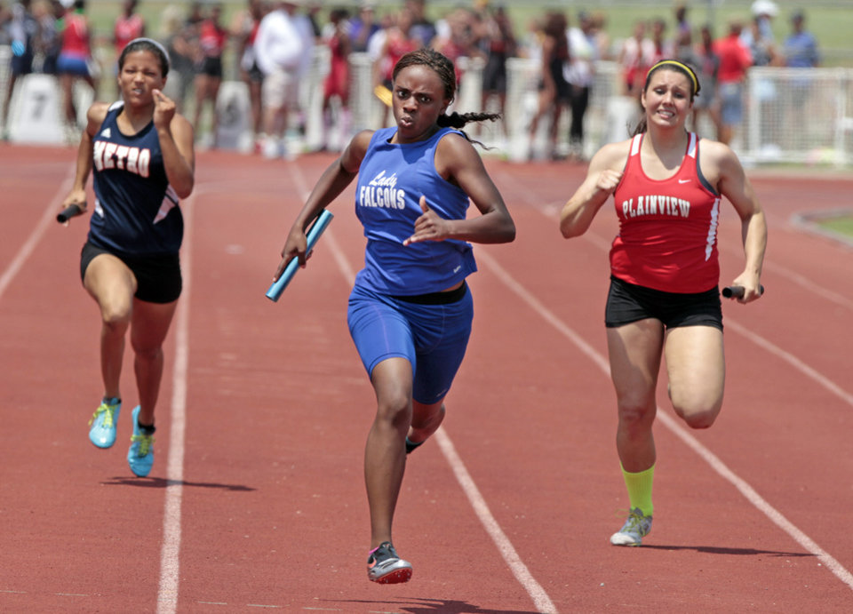 Millwood's Dierdra Marsh (center) runs the final leg as the Falcons win the girls 4x200 at the 3A and 4A state championship track meet on Saturday, May 5, 2012, in Ardmore, Okla.  Photo by Steve Sisney, The Oklahoman