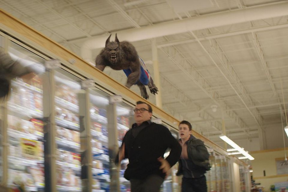 Photo -  Jack Black, left, and Dylan Minnette flee from a werewolf in the movie