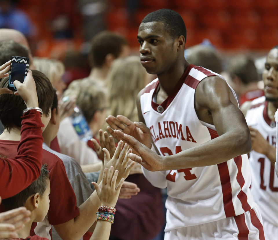 Photo - Oklahoma Sooner's Buddy Hield (24) greets fans after the buzzer as the University of Oklahoma Sooners (OU) men defeat the Iowa State Cyclones (ISU) 87-82 in NCAA, college basketball at The Lloyd Noble Center on Saturday, Jan. 11, 2014  in Norman, Okla. Photo by Steve Sisney, The Oklahoman
