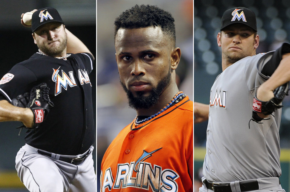 This photo combo made from file photos shows Miami Marlins players, from left, pitcher Mark Buehrle, shortstop Jose Reyes, and pitcher Josh Johnson. Miami traded the three players to the Toronto Blue Jays, a person familiar with the agreement said Tuesday, Nov. 13, 2012. The person confirmed the trade to The Associated Press on condition of anonymity because the teams weren\'t officially commenting. The person said the trade sent several of the Blue Jays\' best young players to Miami. (AP Photos)