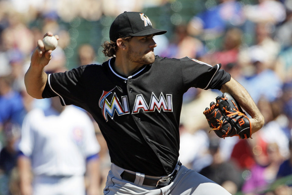 Photo - Miami Marlins starter Nathan Eovaldi throws against the Chicago Cubs during the first inning of a baseball game in Chicago, Friday, June 6, 2014. (AP Photo/Nam Y. Huh)