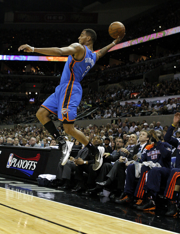 Photo - Oklahoma City's Thabo Sefolosha (2) leaps to save the ball during Game 1 of the Western Conference Finals between the Oklahoma City Thunder and the San Antonio Spurs in the NBA playoffs at the AT&T Center in San Antonio, Texas, Sunday, May 27, 2012. Photo by Bryan Terry, The Oklahoman