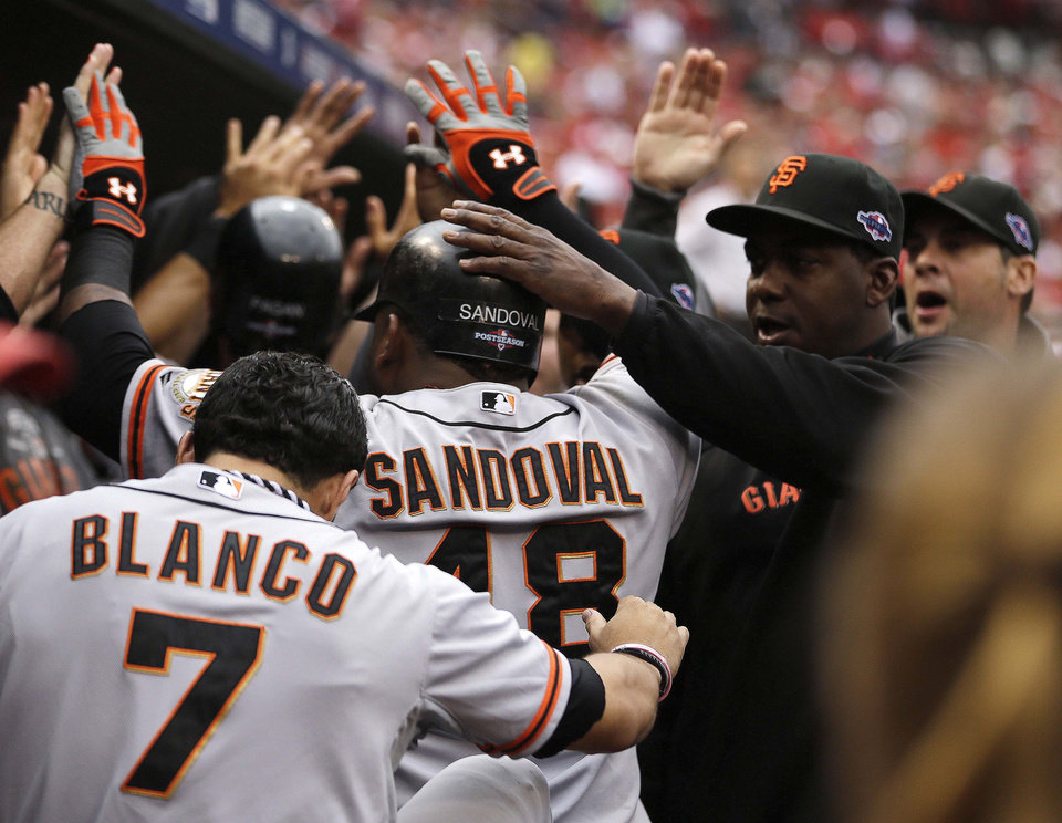 Photo -   San Francisco Giants' Pablo Sandoval (48) celebrates a run as he walks into the dugout during the third inning of Game 3 of baseball's National League championship series against the St. Louis Cardinals Wednesday, Oct. 17, 2012, in St. Louis. (AP Photo/Jeff Roberson)