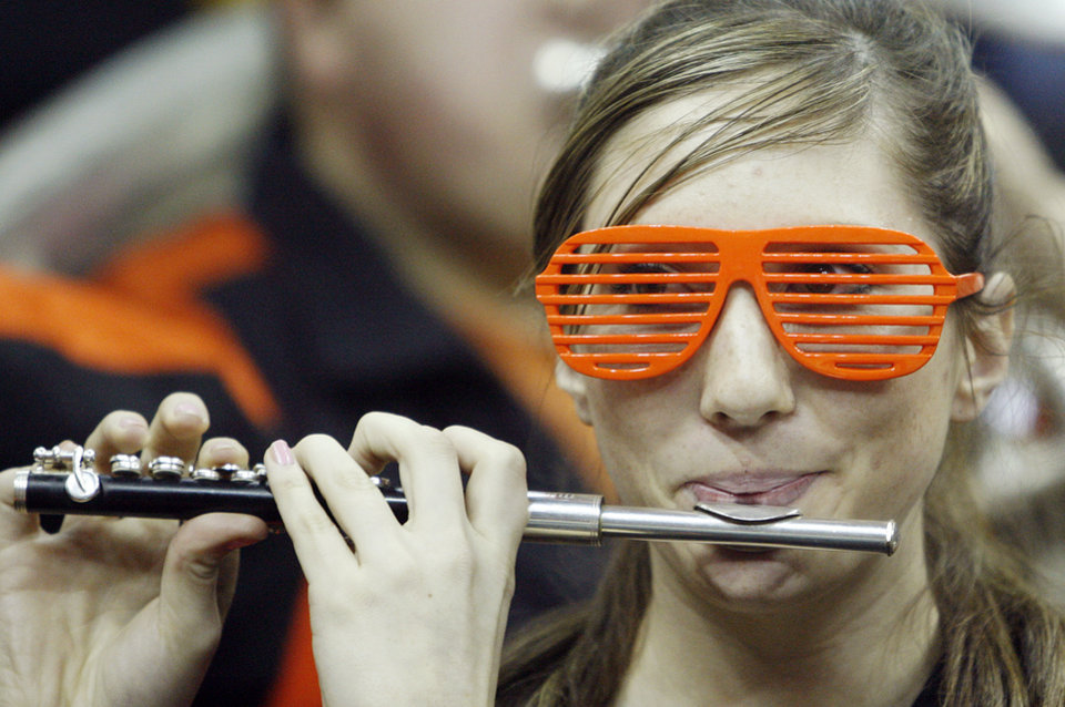 Photo - A member of the Oklahoma State band plays in the first half of the college basketball game during the men's Big 12 Championship tournament at the Sprint Center on Wednesday, March 10, 2010, in Kansas City, Mo. Photo by Chris Landsberger, The Oklahoman