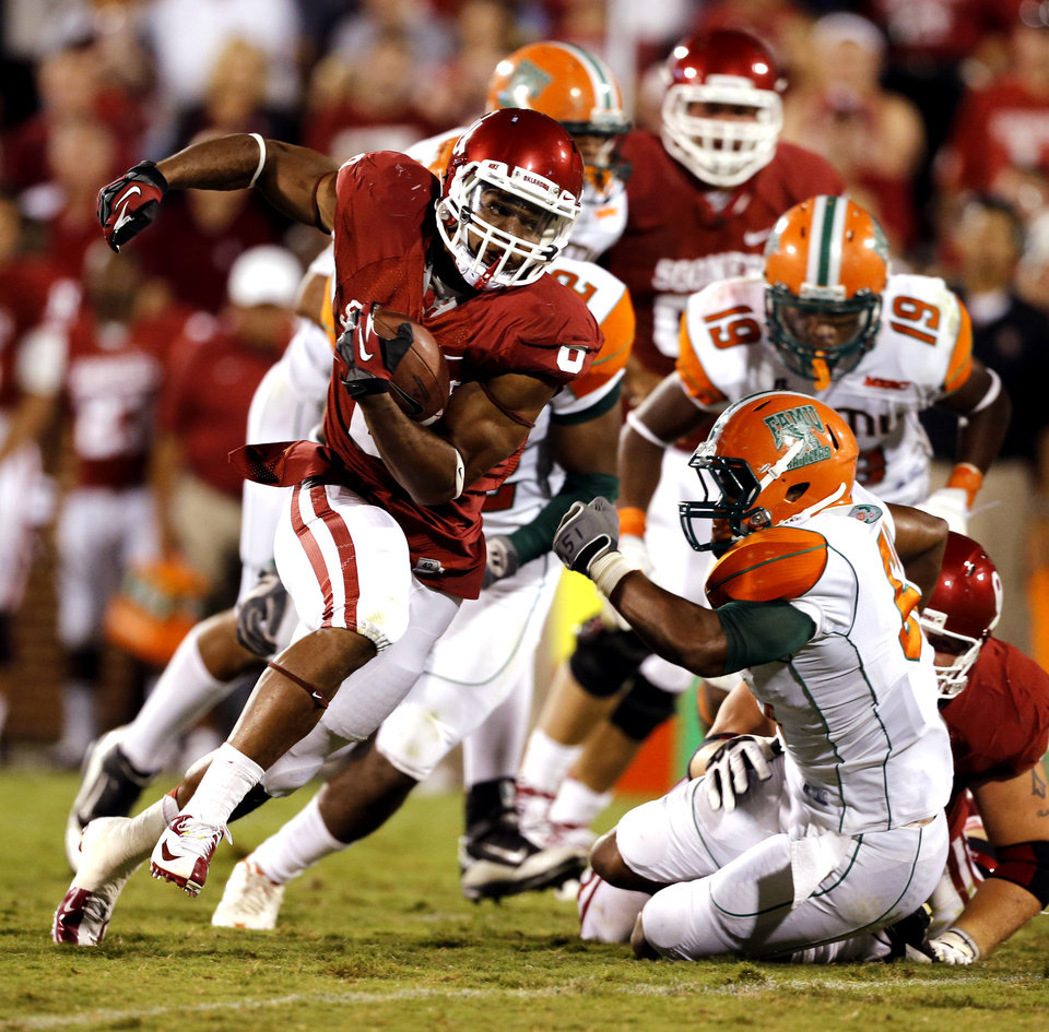Dominique Whaley (8) carries during the second half of the college football game between the University of Oklahoma Sooners (OU) and Florida A&M Rattlers at Gaylord Family—Oklahoma Memorial Stadium in Norman, Okla., Saturday, Sept. 8, 2012. Photo by Steve Sisney, The Oklahoman