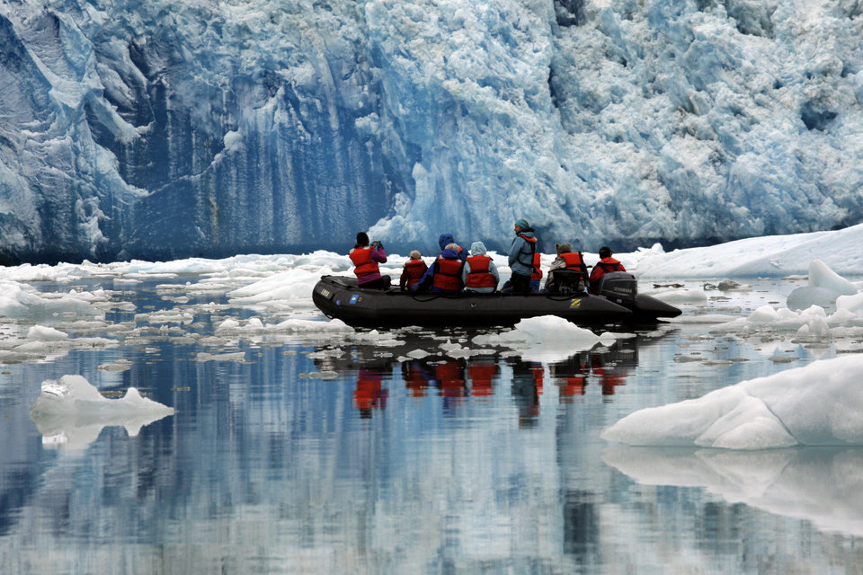 Photo - A zodiac tours the South Sawyer Glacier in Alaska, Sunday, June 3, 2012.  Photo by Sarah Phipps, The Oklahoman