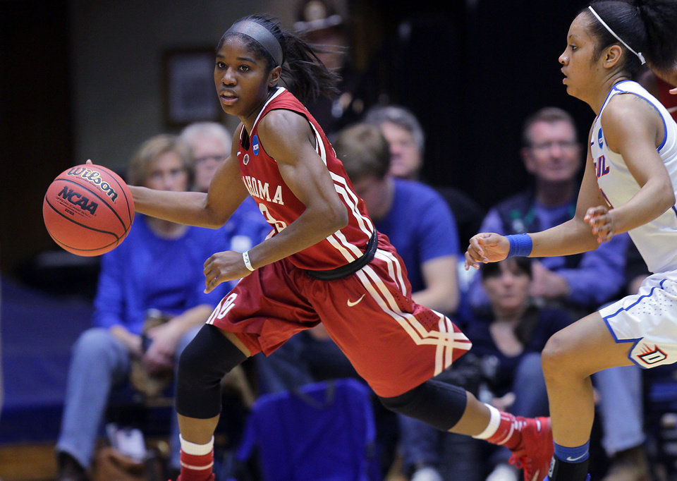 Photo - Oklahoma's Aaryn Ellenberg dribbles the ball up the court during the first half of a first-round game against DePaul in the NCAA basketball tournament in Durham, N.C., Saturday, March 22, 2014. (AP Photo/Ted Richardson)