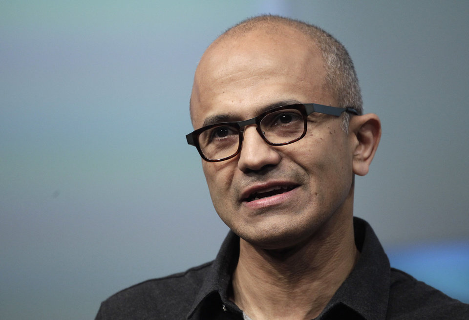 Photo - FILE- In this May 20, 2014 file photo, Satya Nadella, CEO of Microsoft, talks during the introduction the Surface Pro 3 tablet device at a media preview in New York. Microsoft on Thursday, July 17, 2014 announced it will lay off 18,000 workers over the next year. (AP Photo/Mark Lennihan, File)