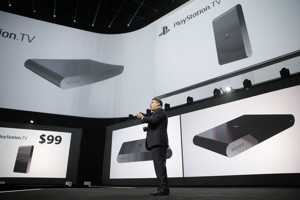 Photo - Shawn Layden, president and CEO of Sony Computer Entertainment America, introduces the PlayStation TV during a presentation at the Electronic Entertainment Expo on Monday, June 9, 2014, in Los Angeles. The $99 device will let users stream video, older PlayStation titles and games for Sony's handheld PlayStation Vita system to any TV. (AP Photo/Jae C. Hong)