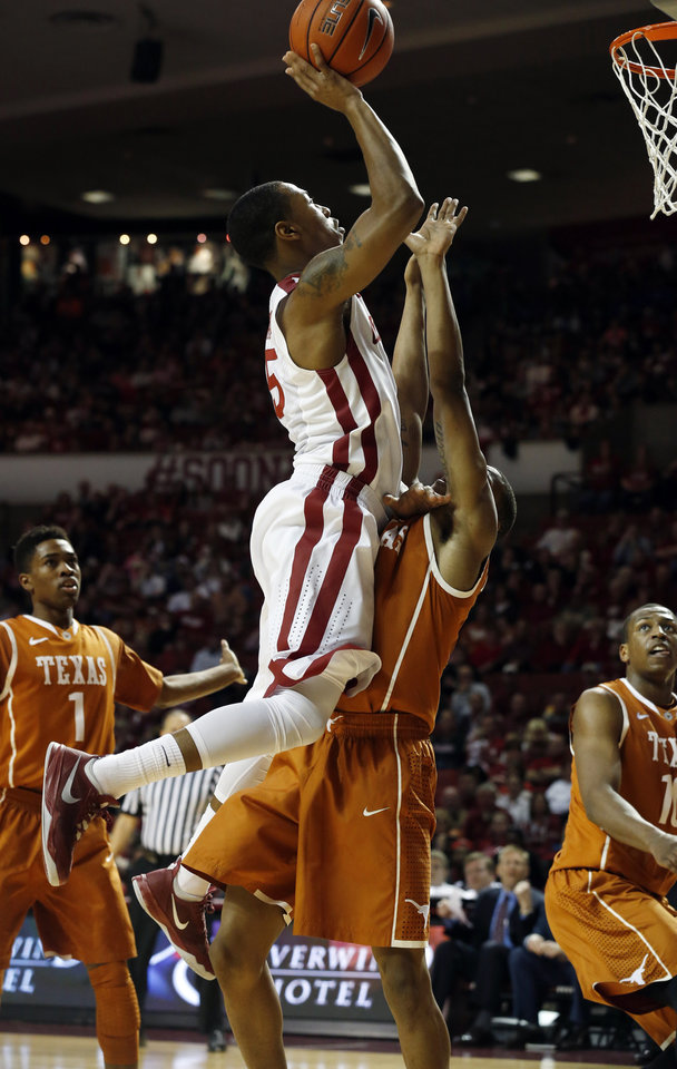Photo - Oklahoma Sooner Je'lon Hornbeak (5) shoots over Demarcus Holland in the second half as the University of Oklahoma Sooners (OU) men defeat the Texas Longhorns (TU) 77-65 in NCAA, college basketball at The Lloyd Noble Center on Saturday, March 1, 2014  in Norman, Okla. Photo by Steve Sisney, The Oklahoman