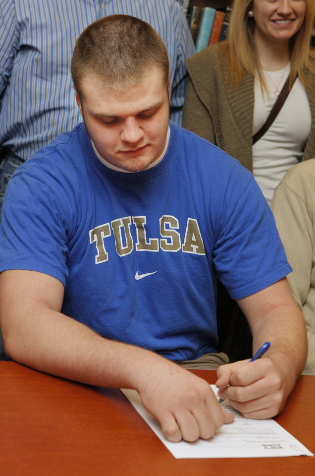 Photo - Blake Belcher signs a letter of intent to play for Tulsa during a signing ceremony in the library at Guthrie High School in Guthrie Wednesday, Feb. 1, 2012. Photo by Paul B. Southerland, The Oklahoman