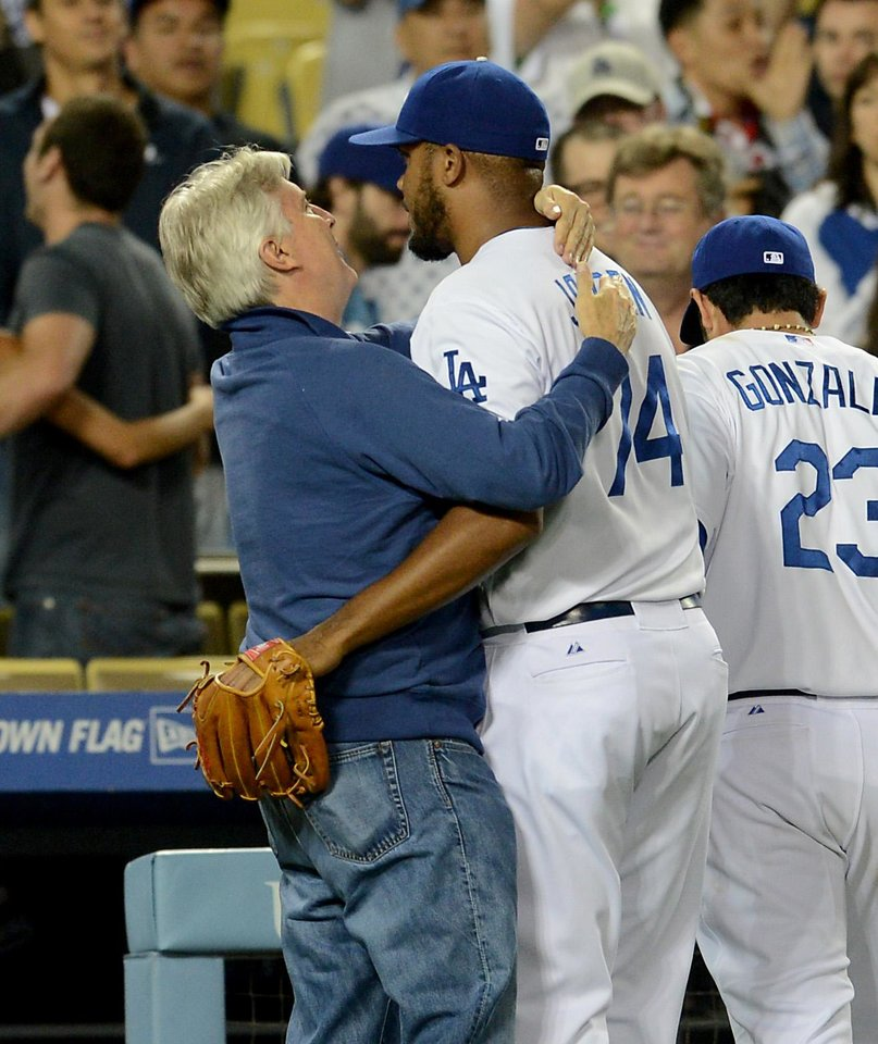 Photo - Los Angeles Dodgers' Kenley Jansen is hugged by Los Angeles Dodgers owner Mark Walter after getting his 19th save of the season in the ninth inning of a baseball game against the Arizona Diamondbacks on Saturday, June 14, 2014, in Los Angeles. (AP Photo/Jayne Kamin-Oncea)