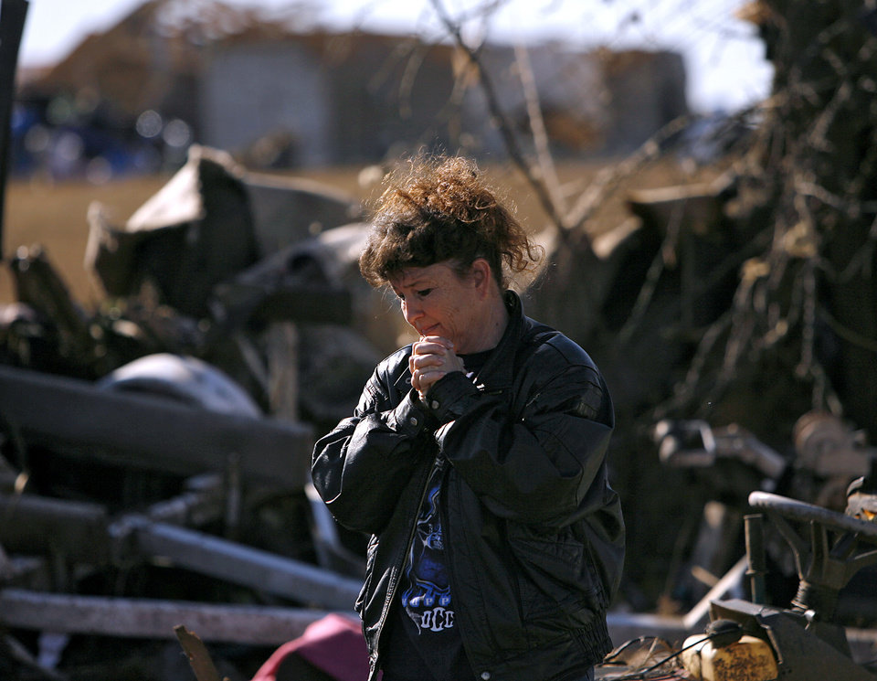 Neda Wilson reacts as she looks at her sister's destroyed home following deadly storms around Lone Grove, Okla., Feb. 11, 2009. By John Clanton, The Oklahoman