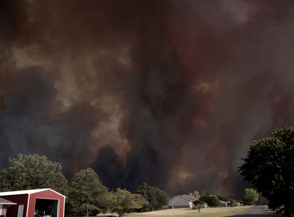 Photo - A large wildfire burns in Luther, Okla., Friday, Aug. 3, 2012. Photo by Sarah Phipps, The Oklahoman