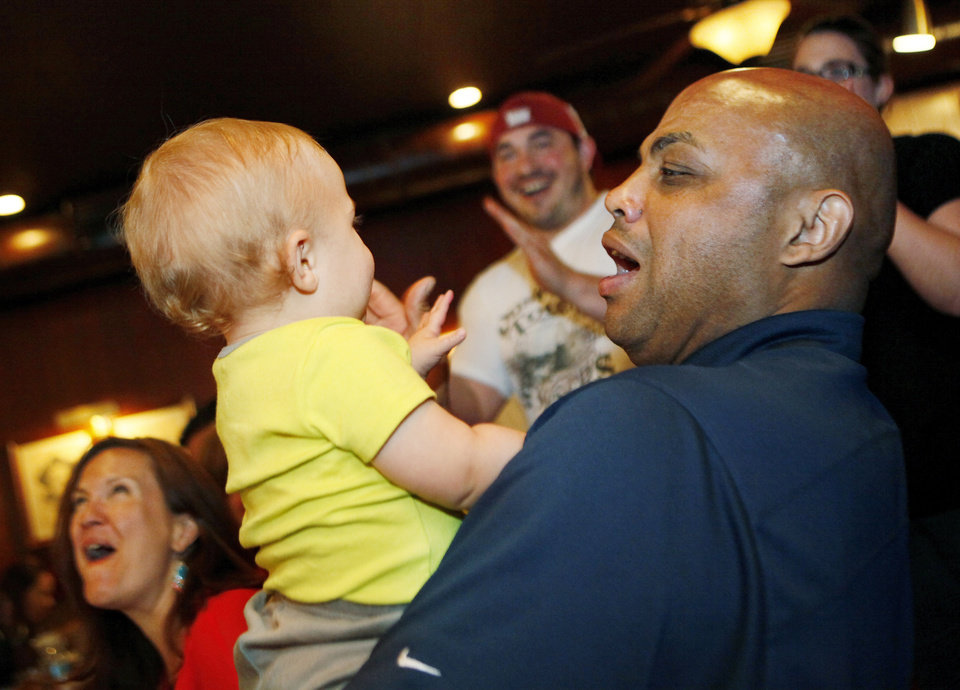 Photo - Charles Barkley holds 14-month-old Ben Price while at Cattlemen's Steakhouse in Oklahoma City, Friday, June 1, 2012.  Barkley had lunch at Cattlemen's as part of a tour of Oklahoma City. Photo by Nate Billings, The Oklahoman