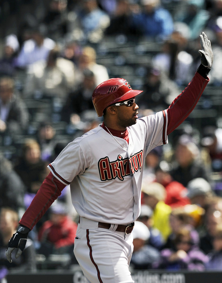 Arizona Diamondbacks Chris Young celebrates a two-run home run in the first inning of a baseball game against the Colorado Rockies on Sunday, April 15, 2012 in Denver. (AP Photo/Chris Schneider)