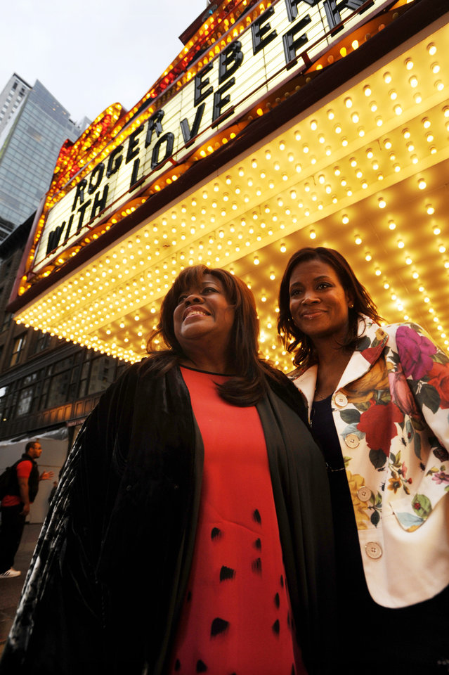 Photo - Roger Ebert's wife Chaz Ebert, left, and her daughter Sonia Evans, right, arrive at The Chicago Theater before a memorial for film critic Roger Ebert in Chicago, Thursday, April 11, 2013. The Pulitzer Prize winning critic died last week at the age of 70 after a long battle with cancer. (AP Photo/Paul Beaty)