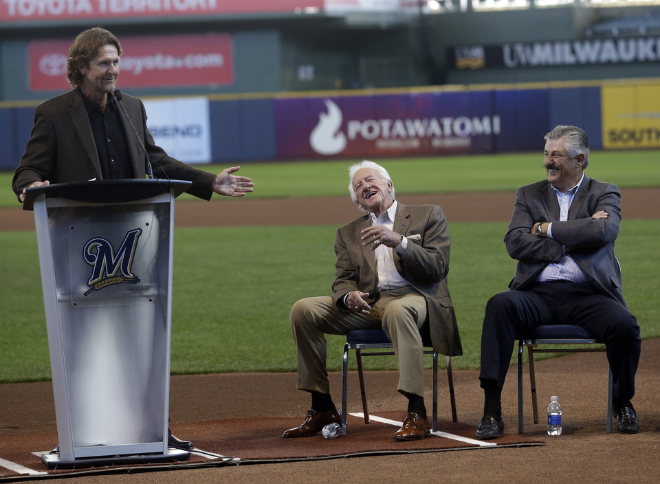 Photo - Milwaukee Brewers radio announcer Bob Uecker laughs with Rolly Fingers, right, as Robin Yount speaks at an event Friday, April 25, 2014, at Miller Park in Milwaukee. A statue of the Hall of Fame broadcaster will debut the Brewer's game against the Chicago Cubs. (AP Photo/Morry Gash)