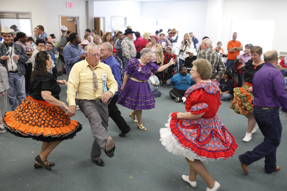 Photo - Members of the Central District Square Dance Association perform during a Dale Rogers Center party. Photos by David McDaniel, The Oklahoman