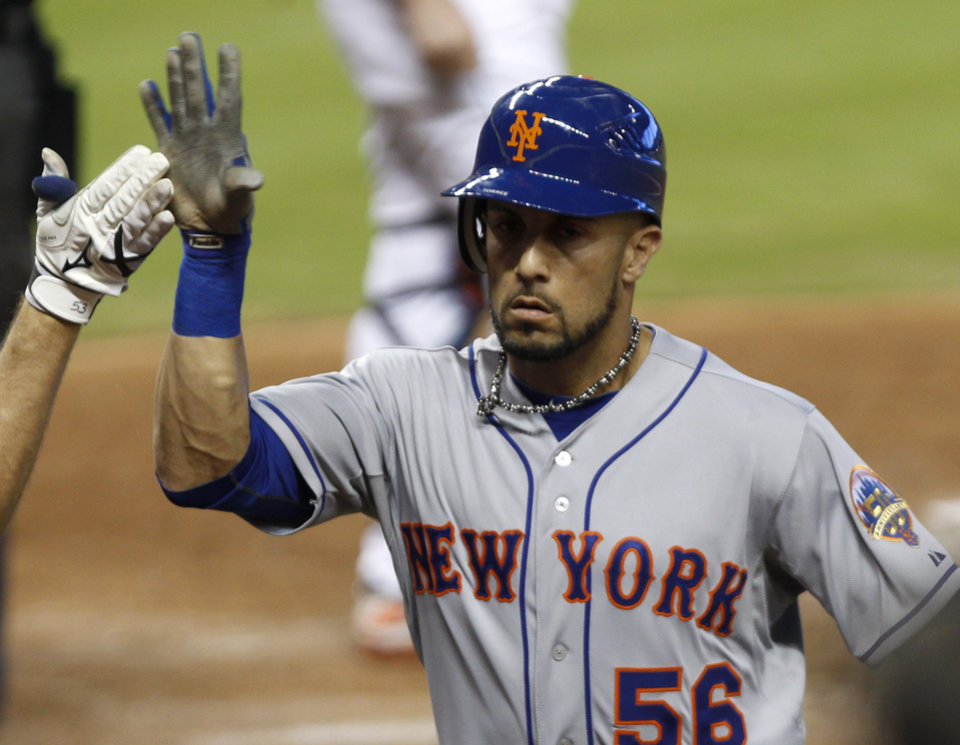 New York Mets' Andres Torres gets a high-five after batting a solo home run against the Miami Marlins in the third inning of a baseball game in Miami, Wednesday, Oct. 3, 2012. (AP Photo/Alan Diaz)