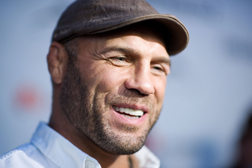 Photo -  Randy Couture, who was a three-time All-American and an anchor on Oklahoma State's 1990 national championship team, will receive the Distinguished American honor from the National Wrestling Hall of Fame this weekend. [AP FILE PHOTO]