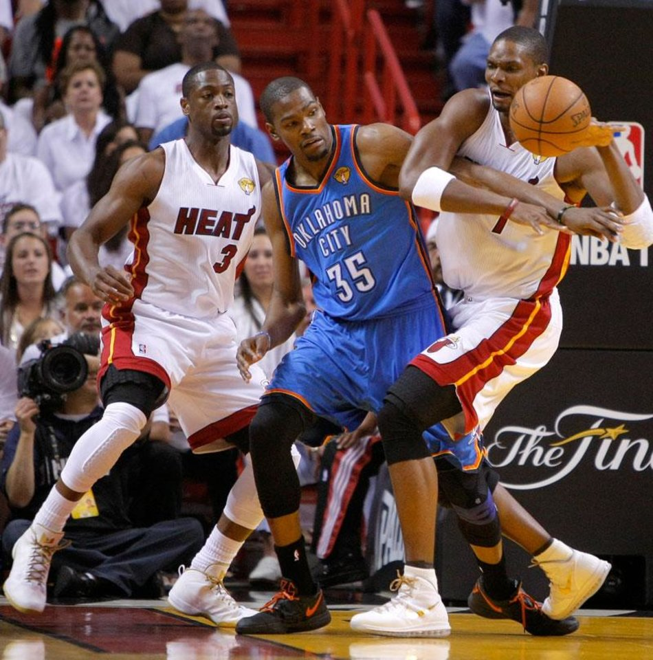 Photo -  Oklahoma City's Kevin Durant (35) fights for the ball with Miami's Chris Bosh (1) and Dwyane Wade (3) watches during Game 3 of the NBA Finals between the Oklahoma City Thunder and the Miami Heat at American Airlines Arena, Sunday, June 17, 2012. Photo by Bryan Terry, The Oklahoman