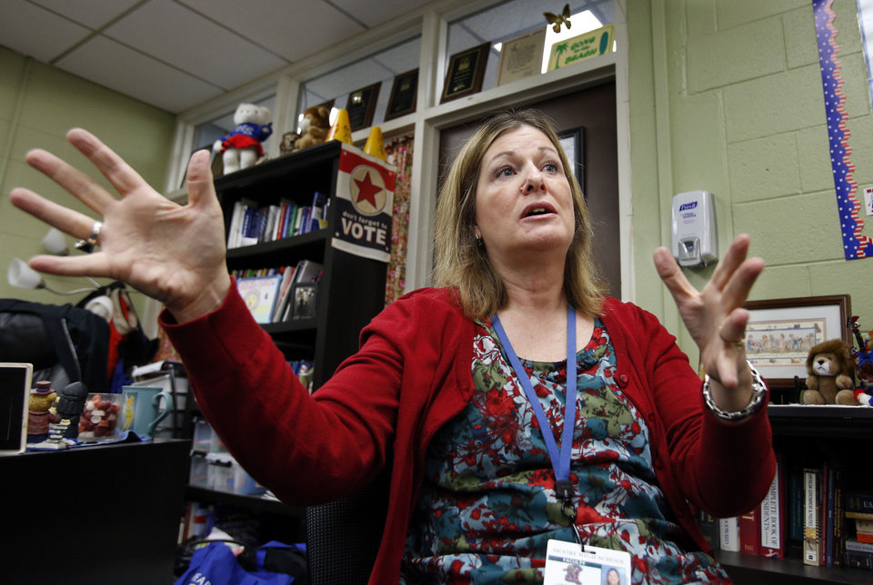 Photo - Liz Butcher discusses the government class she teaches at Moore High School.  Photo by Steve Sisney, The Oklahoman