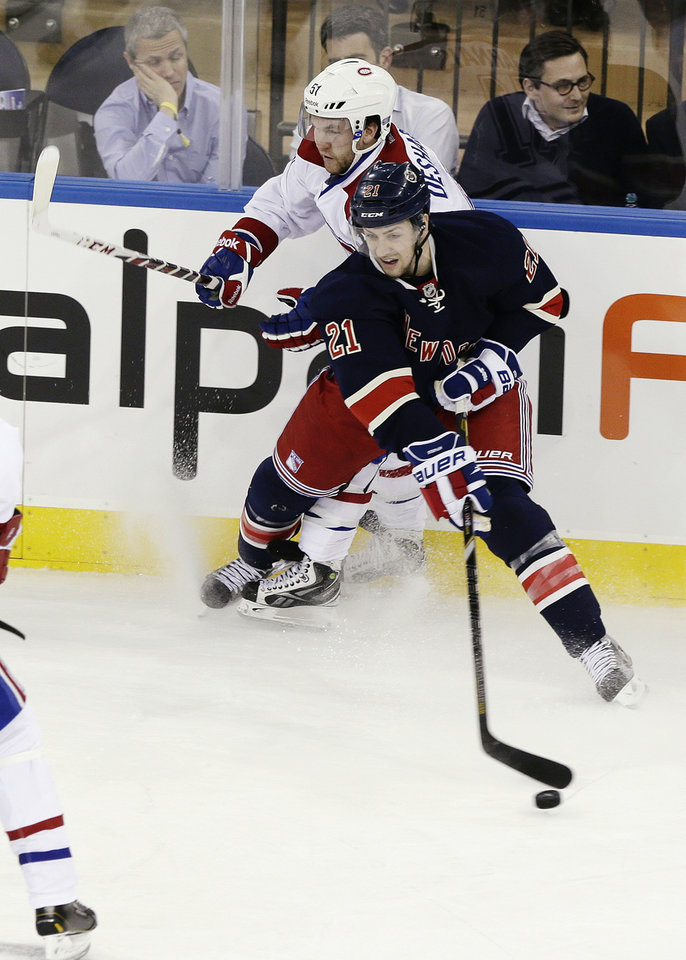 Photo - New York Rangers' Derek Stepan (21) and Montreal Canadiens' David Desharnais (51) fight for control of the puck during the first period of an NHL hockey game, Tuesday, Feb. 19, 2013, in New York. (AP Photo/Frank Franklin II)